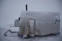 "Утро после пурги. Вид сбоку на жилой балок после пурги / Morning after a blizzard. View of a ""balok"" after a snowstorm."